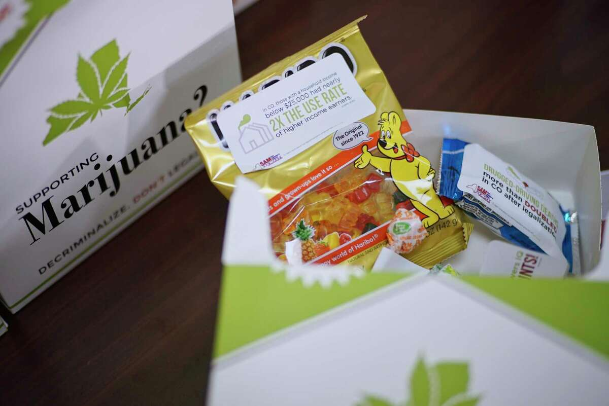 """A view of the """"Pot Packs"""" which along with information had examples of the kind of products that are being sold in other states where marijuana has been legalized, is seen at a press event put on by the organization, Smart Approaches to Marijuana New York, at the Legislative Office Building on Wednesday, March 6, 2019, in Albany, N.Y. The event was held by people who were calling on legislators to slow down their rush to legalize marijuana and to study the issue more. The """"Pot Packs"""" were handed out to legislators. (Paul Buckowski/Times Union)"""