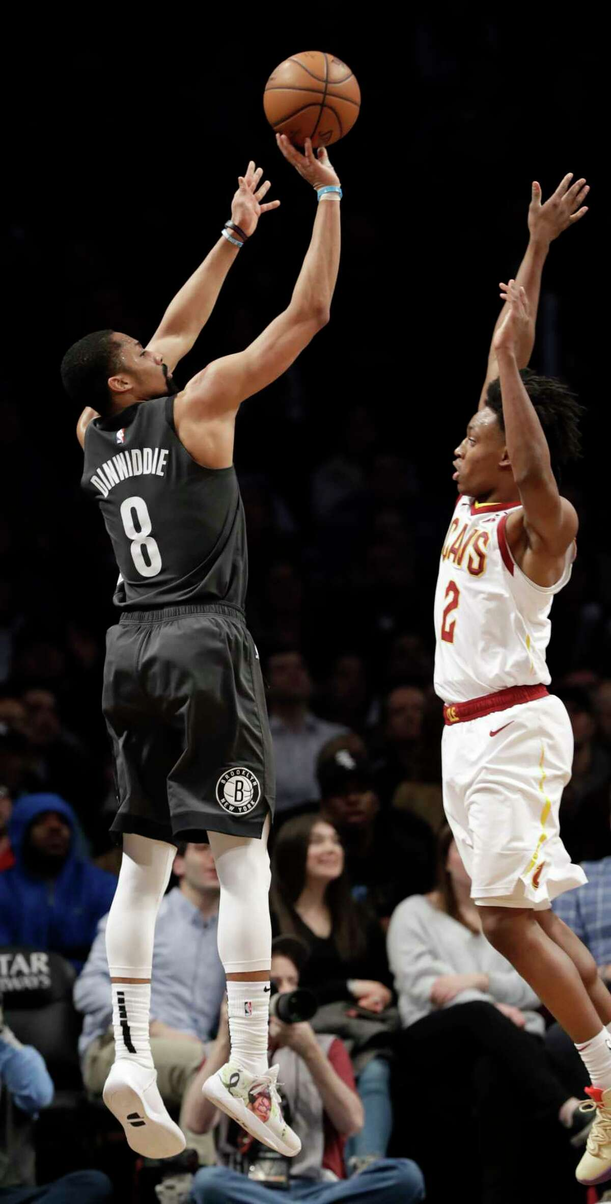 Brooklyn Nets guard Spencer Dinwiddie (8) shoots a 3-pointer as Cleveland Cavaliers guard Collin Sexton (2) defends during the second half of an NBA basketball game Wednesday, March 6, 2019, in New York. (AP Photo/Kathy Willens)