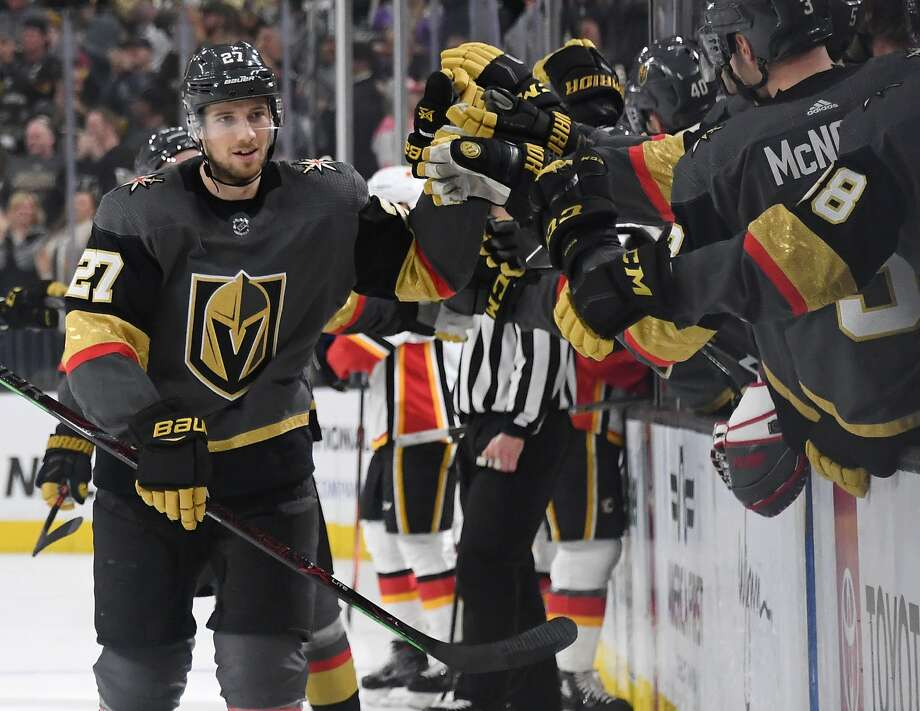 Vegas forward Shea Theodore is congratulated after scoring a first-period goal against Calgary. Photo: Ethan Miller / Getty Images