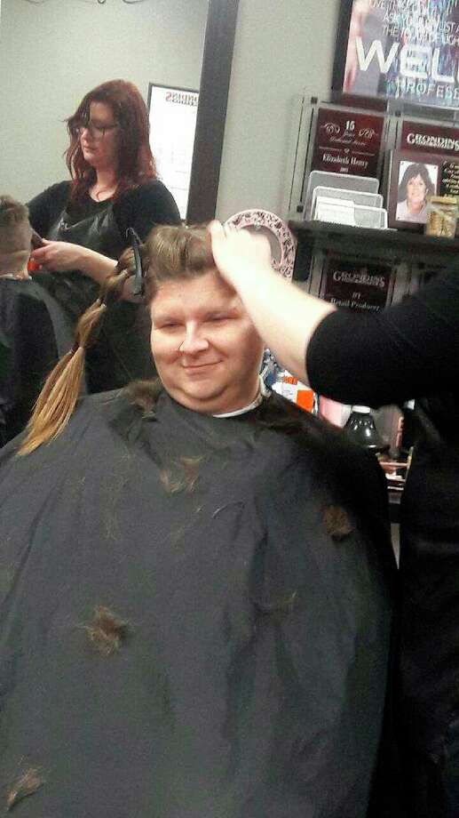 Members First Credit Union employee Melanie Duke while her head is shaved. (Photo provided)