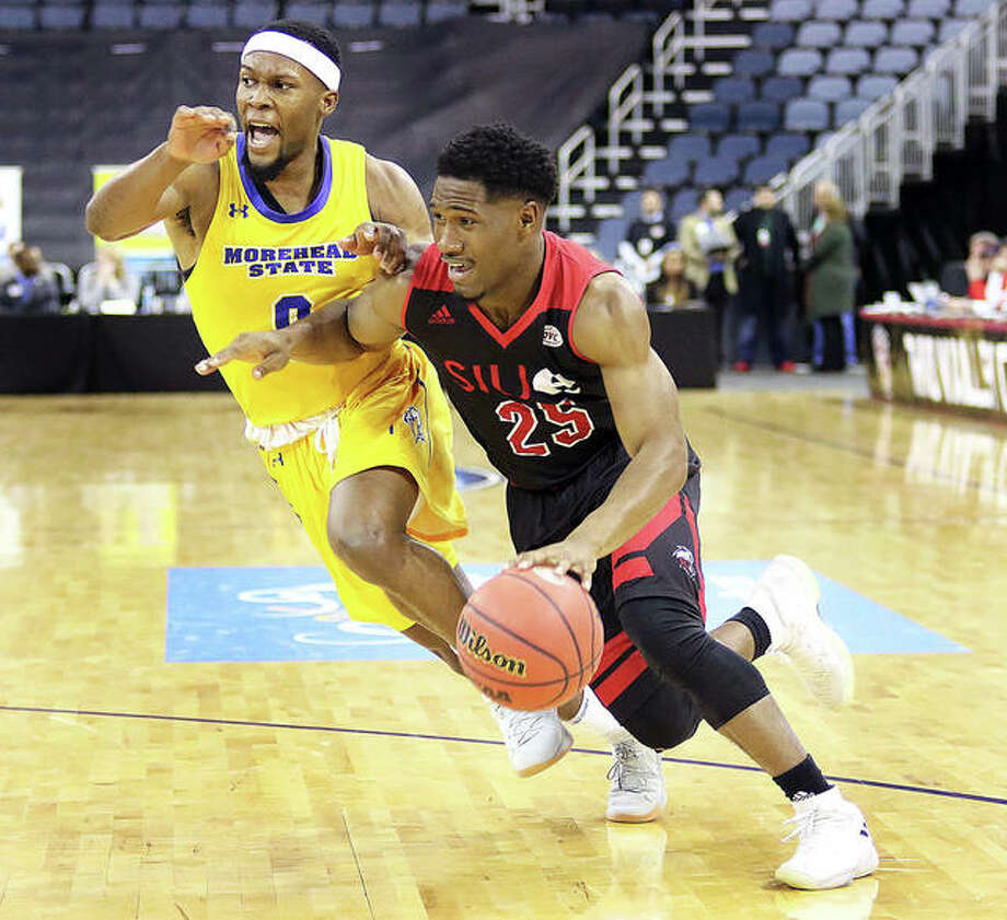 SIUE's Jaylen McCoy (right) drives past Morehead State's A.J. Hicks during the first half Wednesday night in a first-round game at the Ohio Valley Conference Tourney in Evansville. Photo: Greg Shashack | The Telegraph