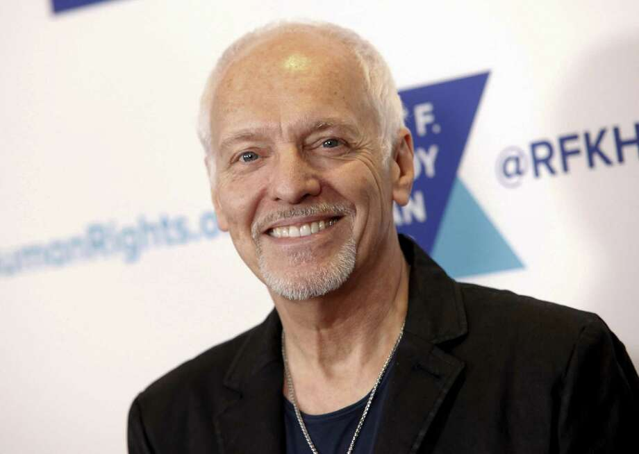 In this Dec. 13, 2017 file photo, Peter Frampton attends the 2017 Ripple of Hope Awards in New York. Doctors at Johns Hopkins University hope to raise awareness and funds for research following Frampton's announcement that he has a rare muscular disease. The disease causes weakness in the legs, forearms and fingers, and its cause is still unknown. As it will eventually prevent Frampton from playing guitar, the 68-year-old is embarking on a farewell tour this summer. Photo: Andy Kropa / Associated Press / 2017 Invision