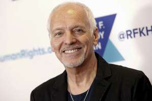 In this Dec. 13, 2017 file photo, Peter Frampton attends the 2017 Ripple of Hope Awards in New York. Doctors at Johns Hopkins University hope to raise awareness and funds for research following Frampton's announcement that he has a rare muscular disease. The disease causes weakness in the legs, forearms and fingers, and its cause is still unknown. As it will eventually prevent Frampton from playing guitar, the 68-year-old is embarking on a farewell tour this summer.