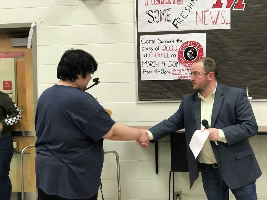 Zachary Tanenbaum shakes hands with Alexander Lumelsky, Tournaments Coordinator at the Connecticut State Chess Association, after winning his third consecutive Connecticut State Chess Association tournament over the weekend. Photo: Contributed