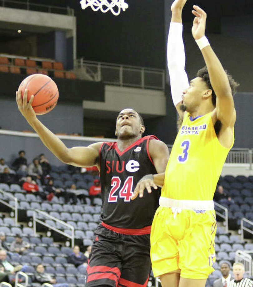 SIUE's Cameron Williams (left) tries to shoot over Morehead State's James Baker on Wednesday night in first-rounc game at the Ohio Valley Conference Tourney in Evansville. Photo: Greg Shashack | Hearst Newspapers