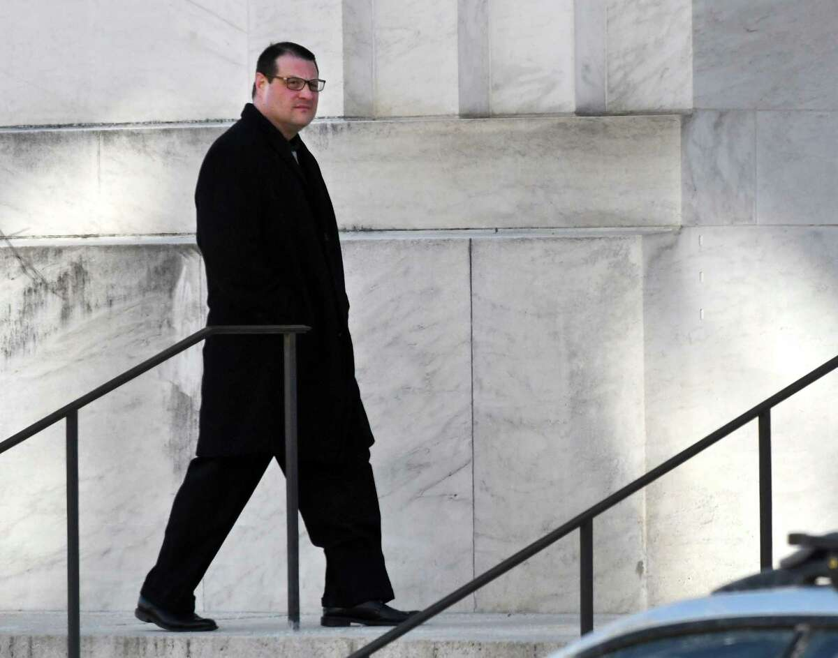 Ralph V. Signoracci, the former longtime campaign treasurer for Cohoes Mayor Shawn M. Morse, enters the James T. Foley Federal Courthouse where he pleaded guilty to a felony wire fraud charge on Thursday, March 7, 2019, in Albany, N.Y. Signoracci, who resigned his positions in December as an Albany County legislator and Cohoes' director of operations, has agreed to cooperate in a federal prosecution of Morse for the alleged misuse of political donations. (Will Waldron/Times Union)