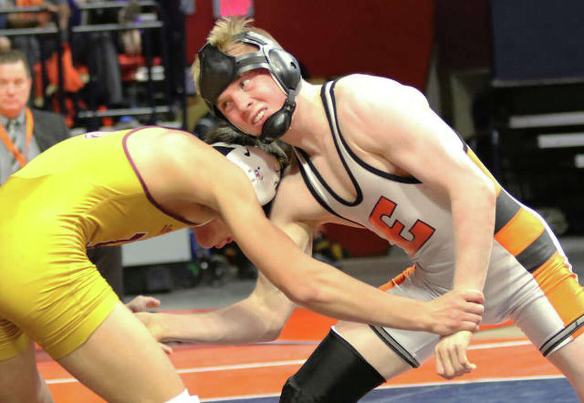 Edwardsville's Noah Surtin (right) wrestles Lockport's Matt Ramos in the 120-pound championship match at the Class 3A state tourney Saturday night at State Farm Center in Champaign.