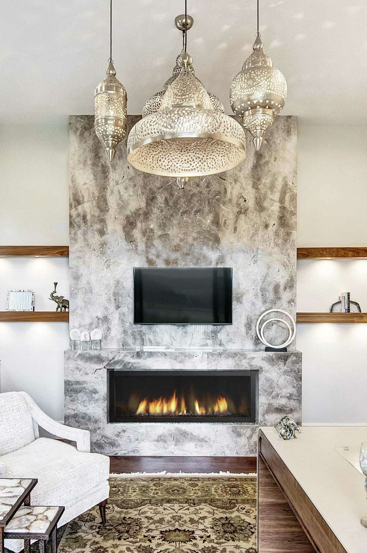 Fior de Bosco marble from Aria Stone Gallery was used around this fireplace.