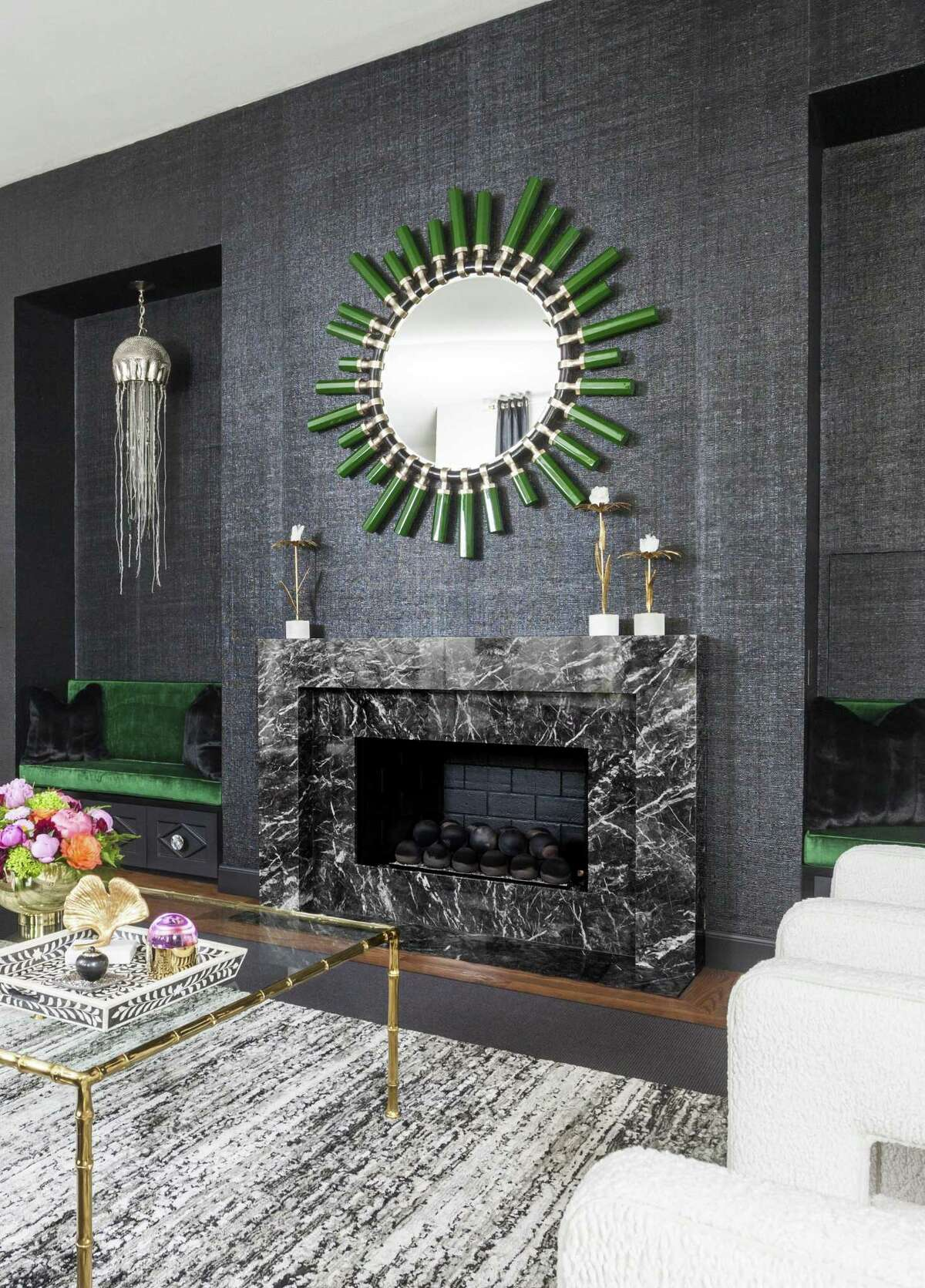 Grigio Carnico marble from Aria Stone Gallery was used around the fireplace in this home.