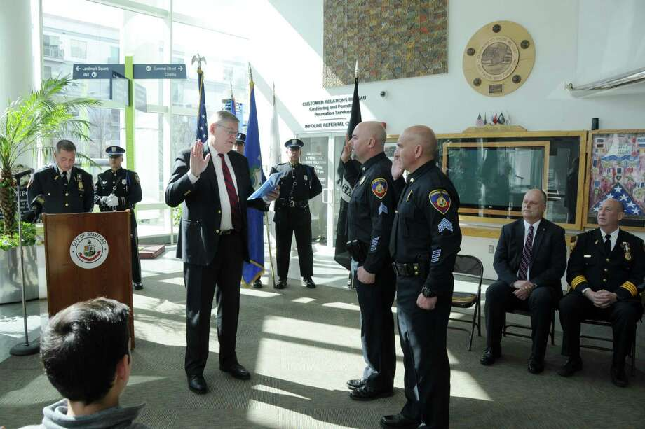 Mayor David Martin swearing in James Comstock and Peter Malanga as sergeants in the lobby of Government Center on Wednesday. Sitting on the right looking on is Director of Public Safety Ted Jankowski and police Chief Jon Fontneau. Photo: Police Officer Ed Rondano / Contributed