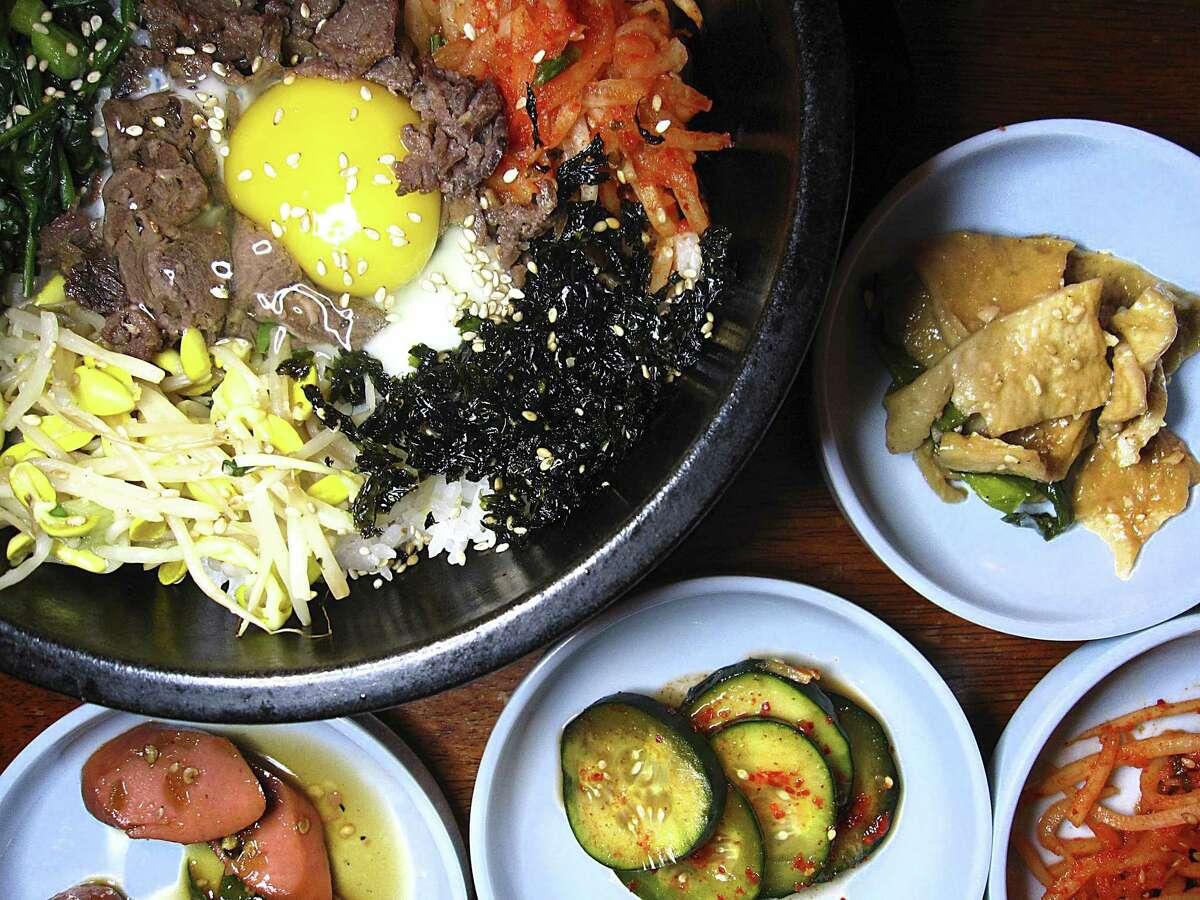 Dolsot bibimbap with beef bulgogi and banchan from Arirang