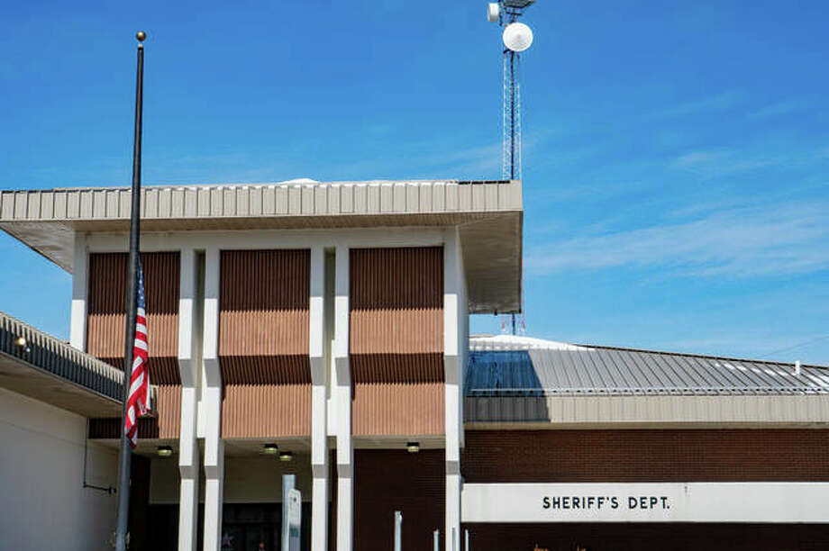Flag flown at half-staff in front of Edwardsville Sheriff Department to honor fallen firefighter Jacob Ringering.