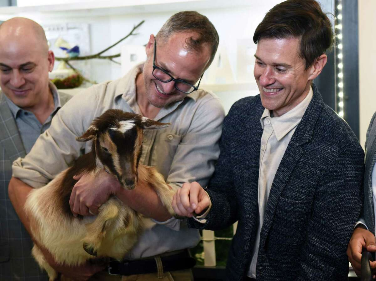 Founders Josh Kilmer-Purcell and Brent Ridge hold a baby goat during the opening of the new headquarters for Beekman 1802 on Thursday, March 7, 2019 in Schenectady, NY. (Phoebe Sheehan/Times Union)