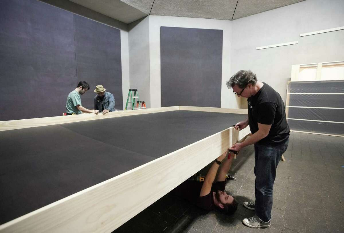 Laramie Justice, on floor, and Scott Peveto, right, along with other Crate Works employees crate one of the paintings in the Rothko Chapel Wednesday, March 6, 2019, in Houston. All of the Mark Rothko canvases will be moved ahead of a major renovation.