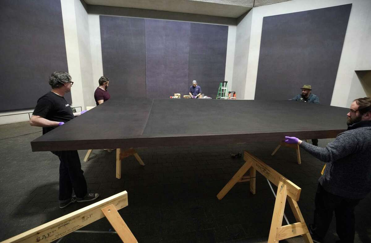 Employees with CrateWorks move a Mark Rothko canvas into a crate on Wednesday, March 6, 2019, in Houston. All of the monumental paintings will be moved ahead of a major renovation.