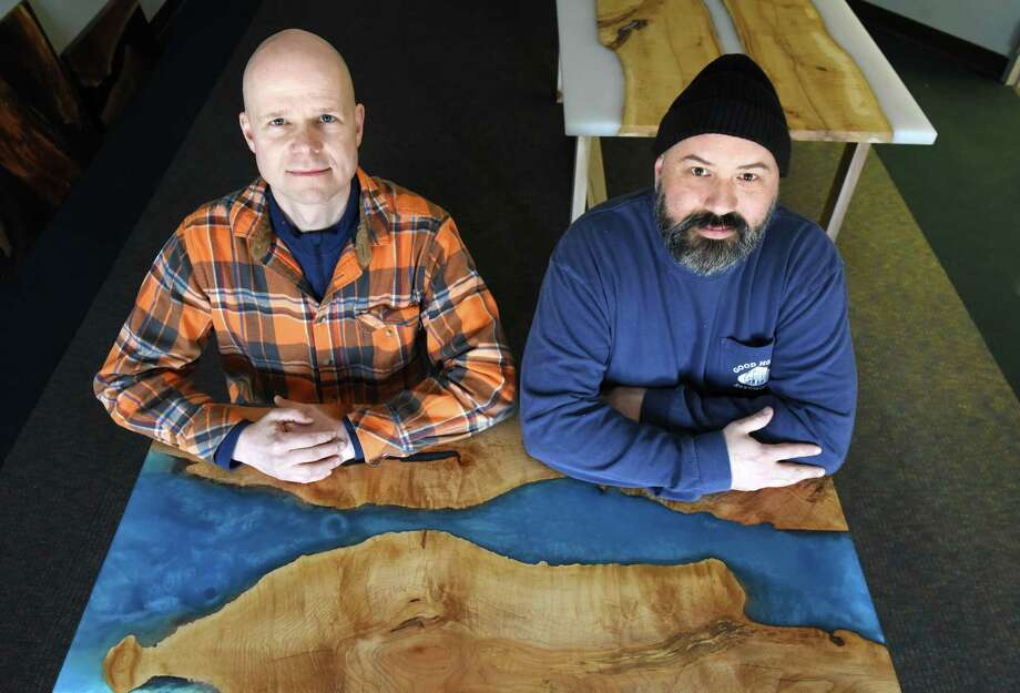Black Fly Mountain Woodworks proprietors; Alexander Bassey, left, and Matt Antico, right, are pictured with one of their artistic table creations on Friday, March 1, 2019, at the showroom in Troy, N.Y.  (Will Waldron/Times Union) Photo: Will Waldron / 20046313A