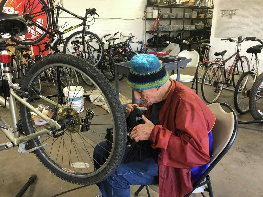Volunteer mechanic Paul Dempsey repairs a bike that was donated to Freewheels Houston. The organization gives bikes to refugees, students and veterans coming out of homelessness. Photo: Tracy Maness