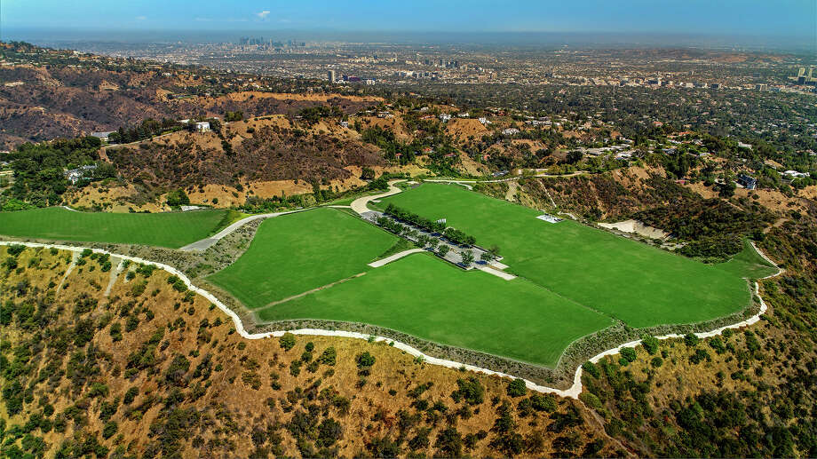 """An undeveloped 157-acre property known as the """"Mountain"""" is now listed for sale at $650 million following a $350-million price cut. The acreage, which measures about twice the size of Disneyland, was once owned by an Iranian royal and talk show host-turned-TV-producer Merv Griffin. (Beth Coller/Los Angeles Times/TNS) Photo: Beth Coller / Los Angeles Times"""