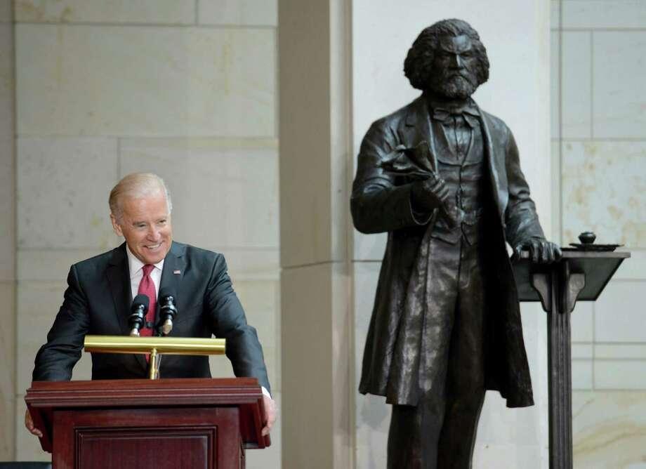 Joe Biden, then vice president, speaks at the 2013 dedication ceremony of Steven Weitzman's Frederick Douglass statue in the U.S. Capitol's Emancipation Hall. Photo: Washington Post Photo By Linda Davidson / The Washington Post
