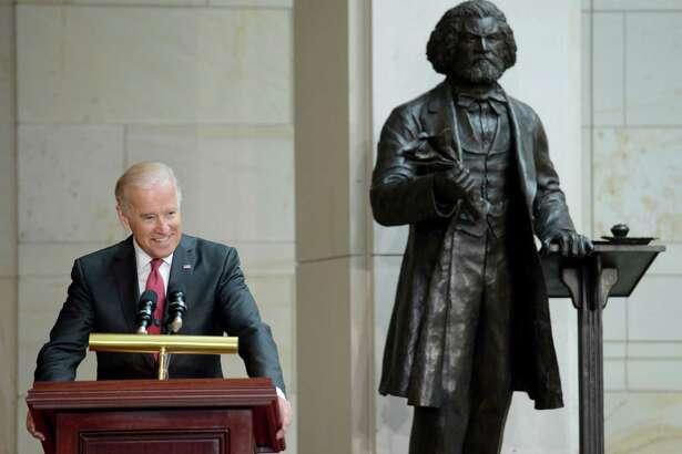 Joe Biden, then vice president, speaks at the 2013 dedication ceremony of Steven Weitzman's Frederick Douglass statue in the U.S. Capitol's Emancipation Hall.