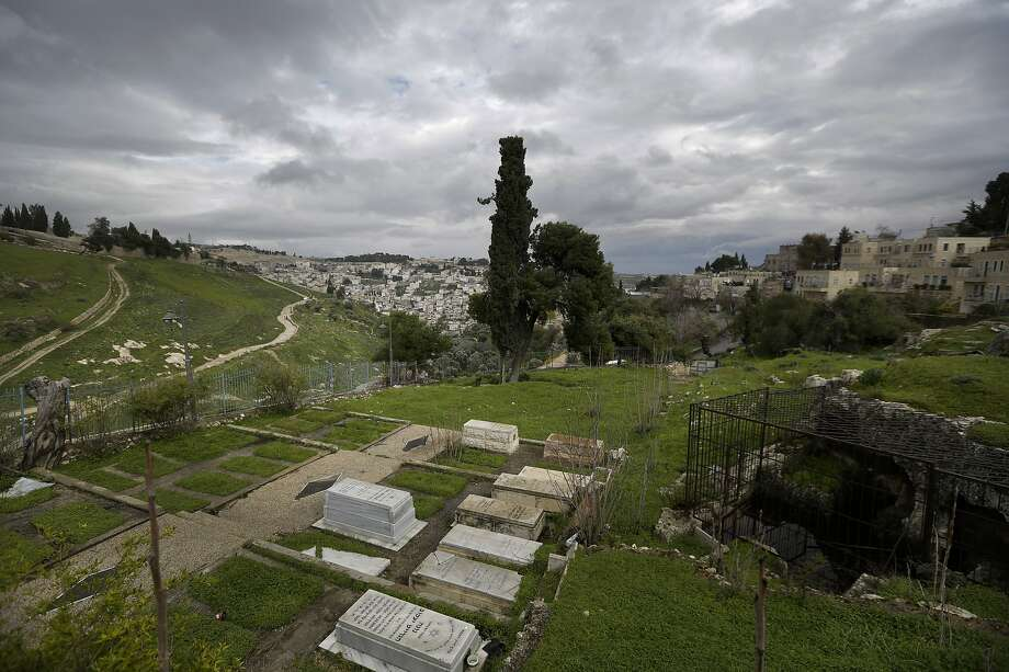 The Karaite Jewish community, a tiny religious sect, fears a proposed cable car to connect modern Jerusalem with its historic Old City will desecrate its ancient cemetery. Photo: Dusan Vranic / Associated Press
