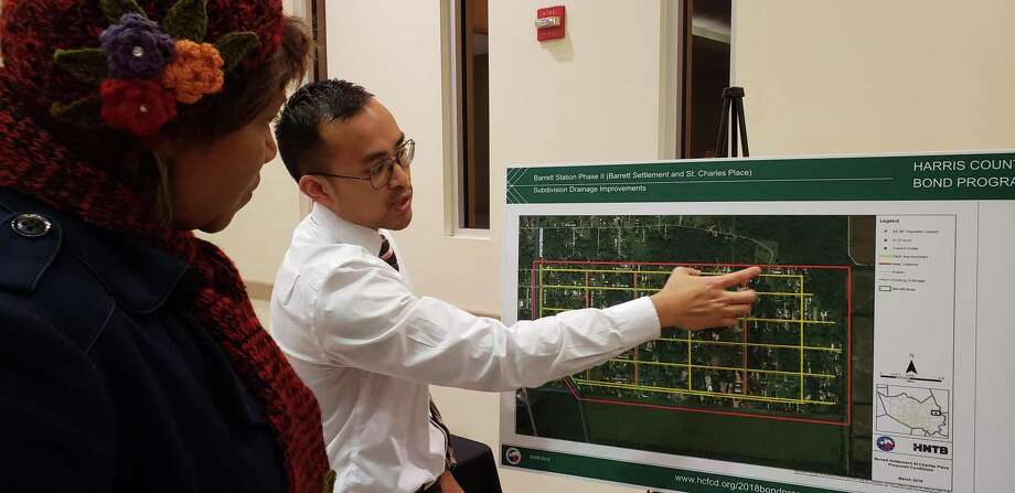 HCFCD Project Manager Roger Duong explains to a Barrett Station resident the proposed drainage improvement projects for the area on March 5, 2019. Photo: Kaila Contreras