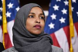 """(FILES) In this file photo taken on November 30, 2018 representative-elect Ilhan Omar, Democrat of Minnesota, attends a press conference in the House Visitors Center at the US Capitol in Washington, DC. - US lawmakers will vote on March 7, 2019, on a measure that condemns anti-Semitism and other forms of hate, House Majority Leader Steny Hoyer said, amid a backlash over controversial comments by Omar. Omar, a former Somali refugee, was assailed by Democrats and Republicans alike for suggesting Friday that supporters of Israel are urging lawmakers to have """"allegiance to a foreign country."""" (Photo by MANDEL NGAN / AFP)MANDEL NGAN/AFP/Getty Images"""