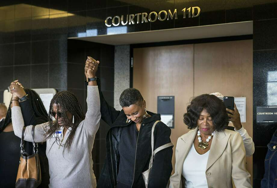 Friends and family of Corey Jones pray after former Florida police officer Nouman Raja was found guilty in a West Palm Beach court. Photo: Greg Lovett / Associated Press