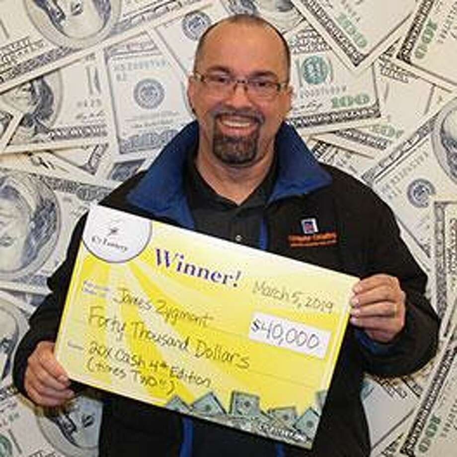 "Computer programmer James Zygmont of Trumbull won the CT Lottery's ""20X Cash"" scratch-off game's top prize, $20,000, twice within minutes Tuesday. Photo: Contributed / CT Lottery / Connecticut Post"