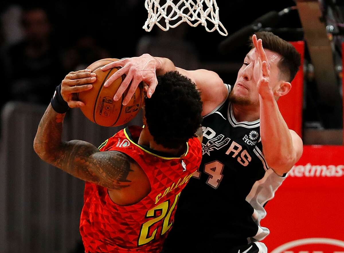 ATLANTA, GEORGIA - MARCH 06: Drew Eubanks #14 of the San Antonio Spurs defends against John Collins #20 of the Atlanta Hawks in the second half at State Farm Arena on March 06, 2019 in Atlanta, Georgia. NOTE TO USER: User expressly acknowledges and agrees that, by downloading and or using this photograph, User is consenting to the terms and conditions of the Getty Images License Agreement. (Photo by Kevin C. Cox/Getty Images)