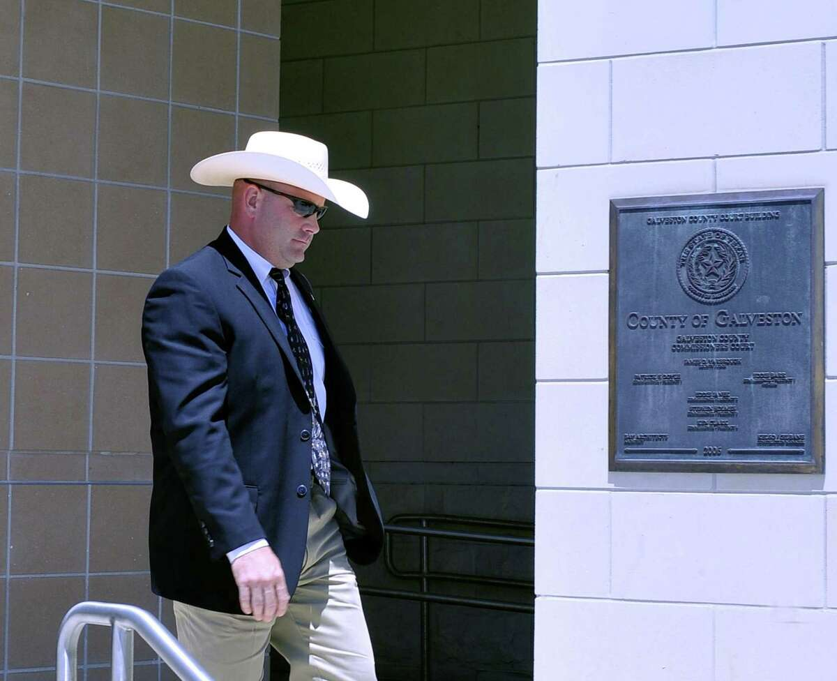 Texas Ranger Brent Davisleaves the front entrance of the Galveston County courthouse in 2013. Davis was demoted in 2017 after he admitted to an affair with the widow of a murder victim.