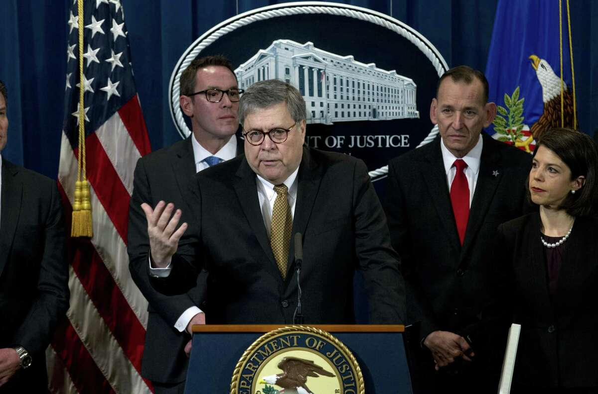 Attorney General William Barr accompanied by other law enforcement officials, speaks during a news conference to address elder financial exploitation and law enforcement actions, at Department of Justice in Washington, Thursday, March 7, 2019.