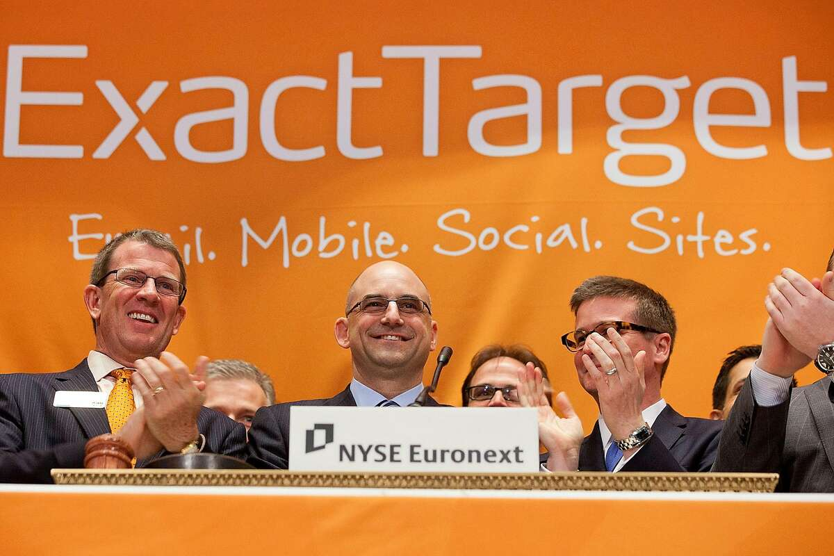 In this photo released by NYSE Euronext, ExactTarget's CEO Scott Dorsey, center, rings the opening bell at the New York Stock Exchange, Thursday, March 22, 2012. The email marketing company is based in Indianapolis, Indiana. (AP Photo/NYSE Euronext, Ben Hider)