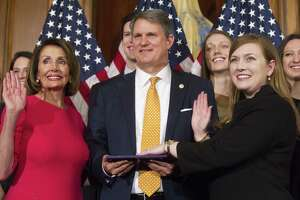 House Speaker Nancy Pelosi of Calif., right, poses during a ceremonial swearing-in with Rep. Lizzie Pannill Fletcher, D-Texas, on Capitol Hill in Washington, Thursday, Jan. 3, 2019, during the opening session of the 116th Congress. Washington, Thursday, Jan. 3, 2019. (AP Photo/Cliff Owen)