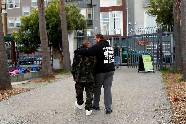 United Playaz' David Monroe (left) and Brandon Jackson confer at Gene Friend Recreation Center in San Francisco, Calif., on Tuesday, January 29, 2019.