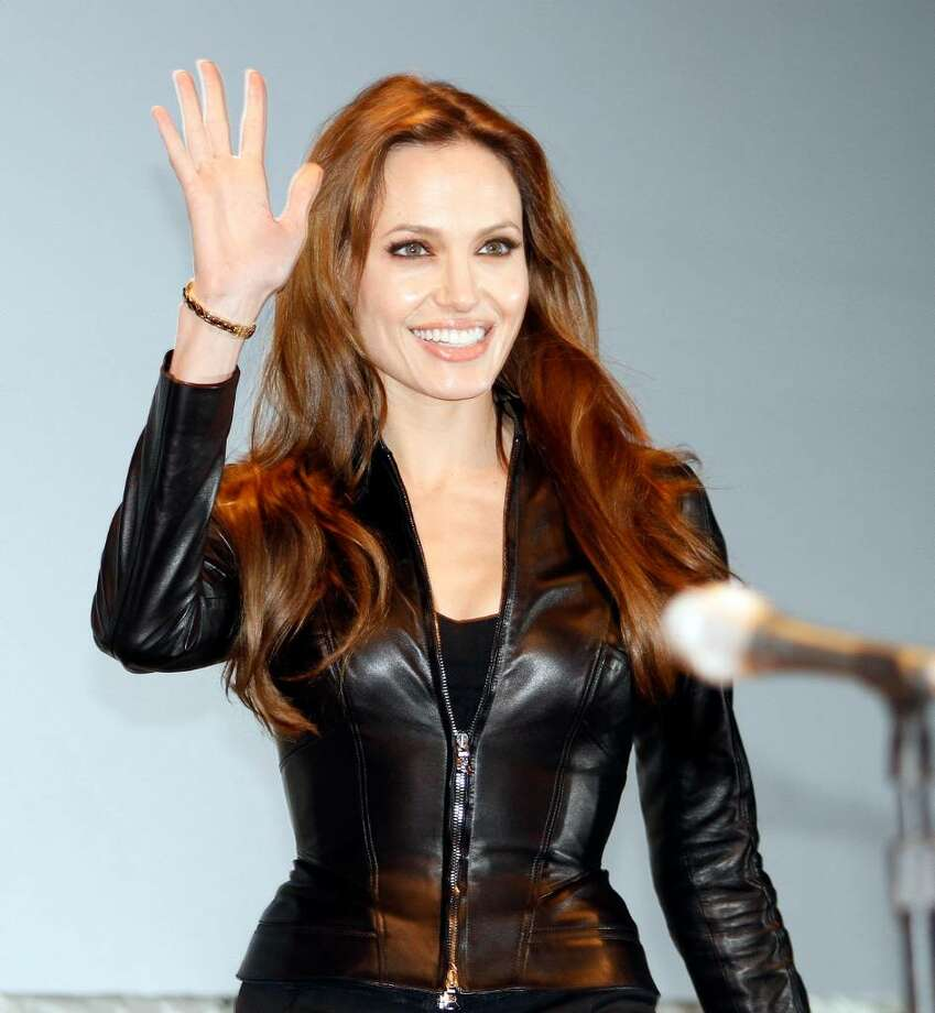 """Actress Angelina Jolie arrives at panel for the movie """"Salt""""  at  Comic-Con International Thursday, July 22, 2010 in San Diego.  (AP Photo/Denis Poroy) Photo: Denis Poroy / FR59680 AP"""