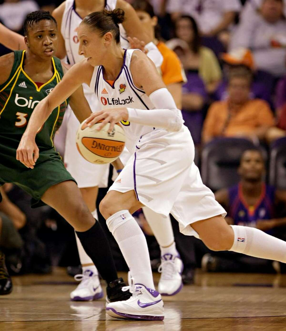 Phoenix Mercury guard Diana Taurasi drives past Seattle Storm guard Tanisha Wright during the second quarter of a WNBA basketball game Wednesday, July 14, 2010, in Phoenix. (AP Photo/Matt York)