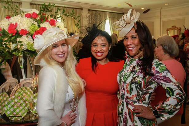 EMBARGOED FOR SOCIETY REPORTER UNTIL MARCH 7 Tracy Faulkner, from left, Shawntell McWilliams and Myrtle Jones at the Hats Off to Mother's Luncheon at River Oaks Country Club.