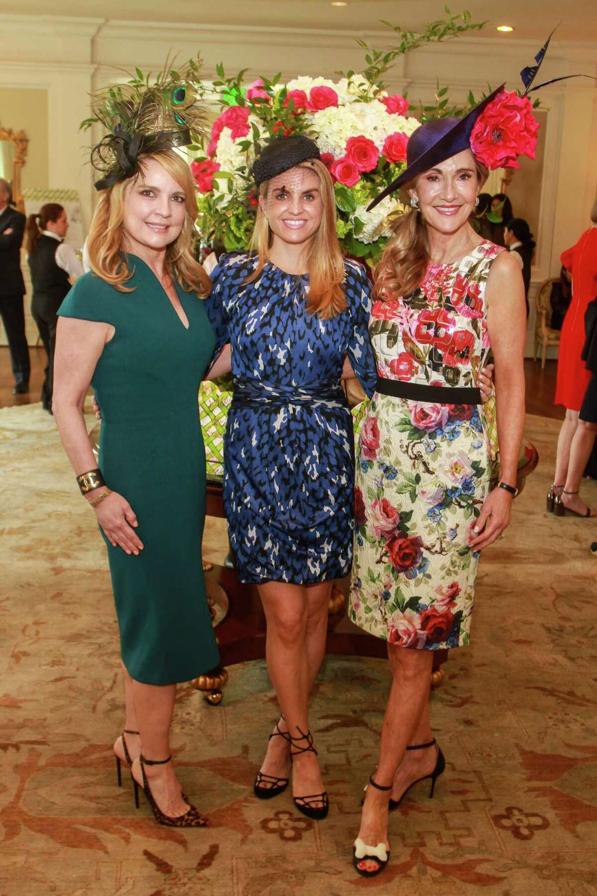 Chairs Melissa Juneau, from left, Lindley Arnoldy and Jana Arnoldy at the Hats Off to Mother's Luncheon at River Oaks Country Club.