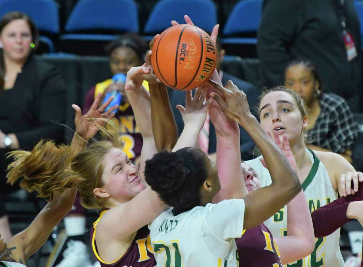 Siena and Iona players fight for a rebound during their game at the MAAC Tournament on Thursday, March 7, 2019, in Albany, N.Y. (Paul Buckowski/Times Union)