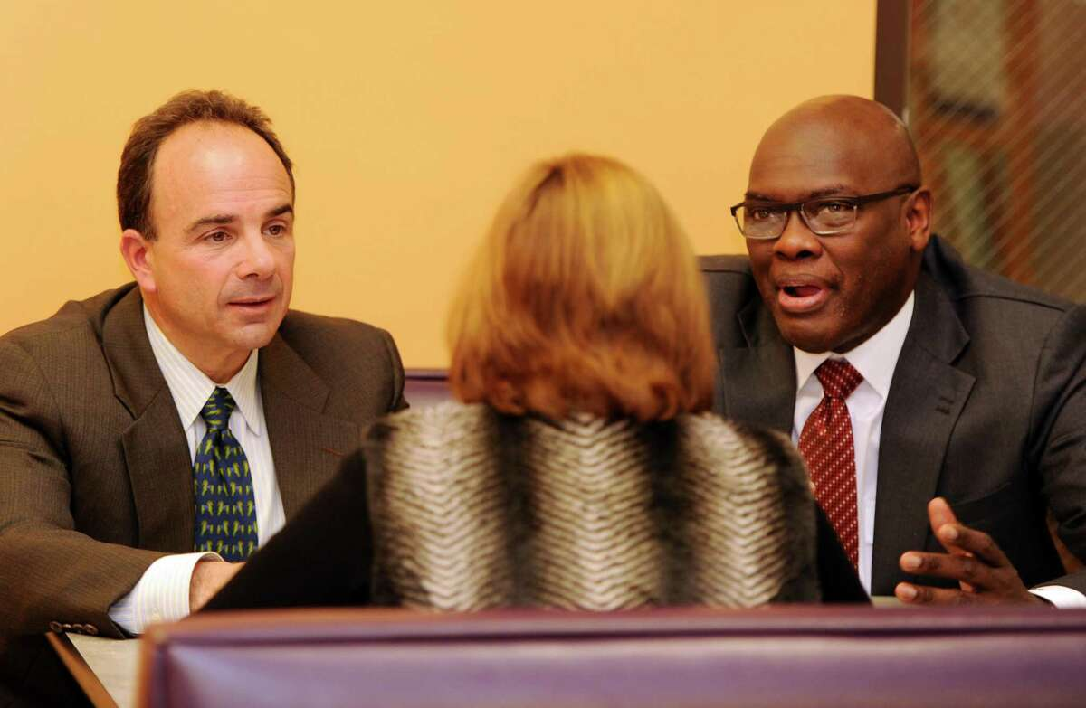 Bridgeport Mayor-elect Joseph Ganim meets with State Rep. Charlie Stallworth and outgoing Town Clerk Alma Maya at the Public Library main branch on Monday Nov.16, 2015 in Bridgeport, Conn.
