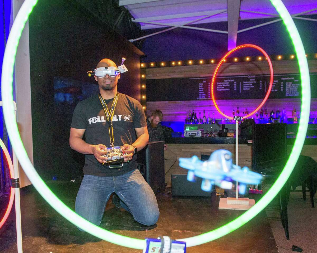Mike Benjamin, a member of the Full Tilt FPV Drone Racing Club, flies his drone through a hoop at the Troy Kitchen on March 5, 2019. (Jim Franco/Special to the Times Union)
