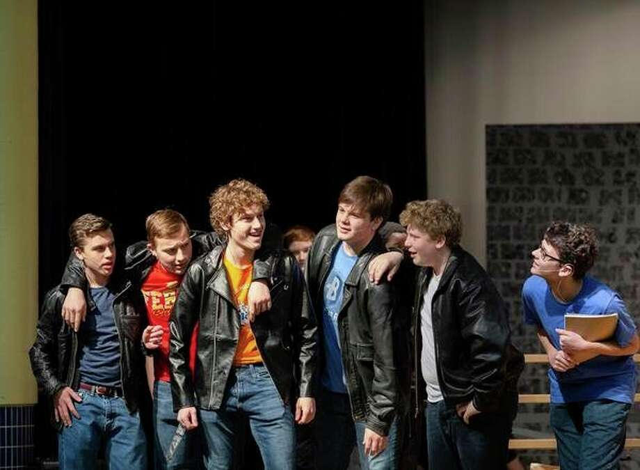 Members of the cast of 'Grease the Musical' rehearse for their play that opens up at 7 p.m., tonight at Bad Axe High School. They will also be performing at 7 p.m., on March 9 and 15, along with 2 p.m., March 10 and 17. (Courtesy Photo) / Abbie Marie Photography