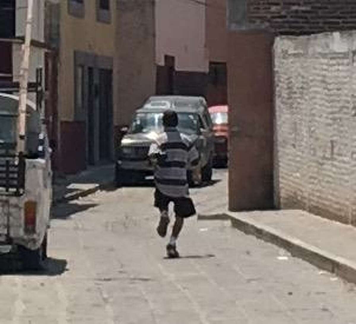 When Dwight Silverman's phone was stolen in 2017 in San Miguel de Allende, Mexico, his wife ised her iPhone to snap this photo of the thief as he sprinted away.