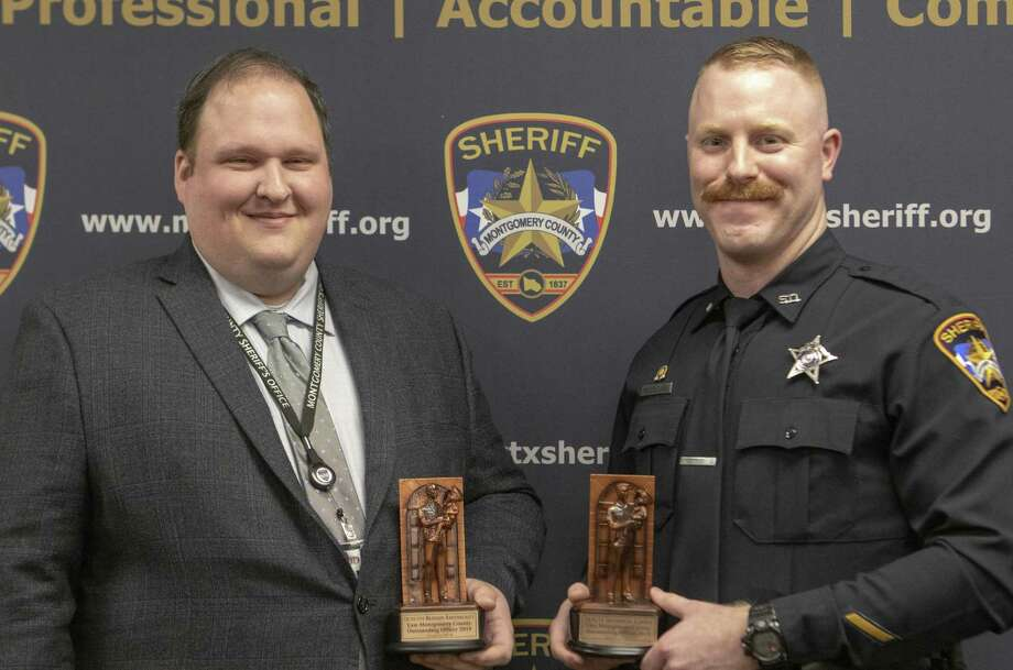 MCSO detective Brandon Bartoskewitz, left, and deputy Nicholas Cooke hold up their awards for East Montgomery County outstanding officers Tuesday, March 5, 2019 at The Montgomery County Sheriff's Office in Conroe.. Photo: Cody Bahn, Houston Chronicle / Staff Photographer / © 2018 Houston Chronicle