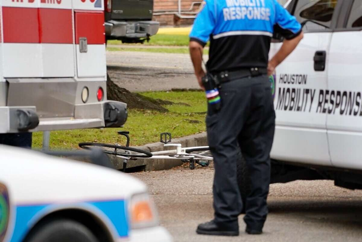 Police and EMS personnel respond to a scene where a cyclist was struck and killed by a HISD school bus at Heights Blvd. and 8th Street in the Heights, Thursday, March 7, 2019.