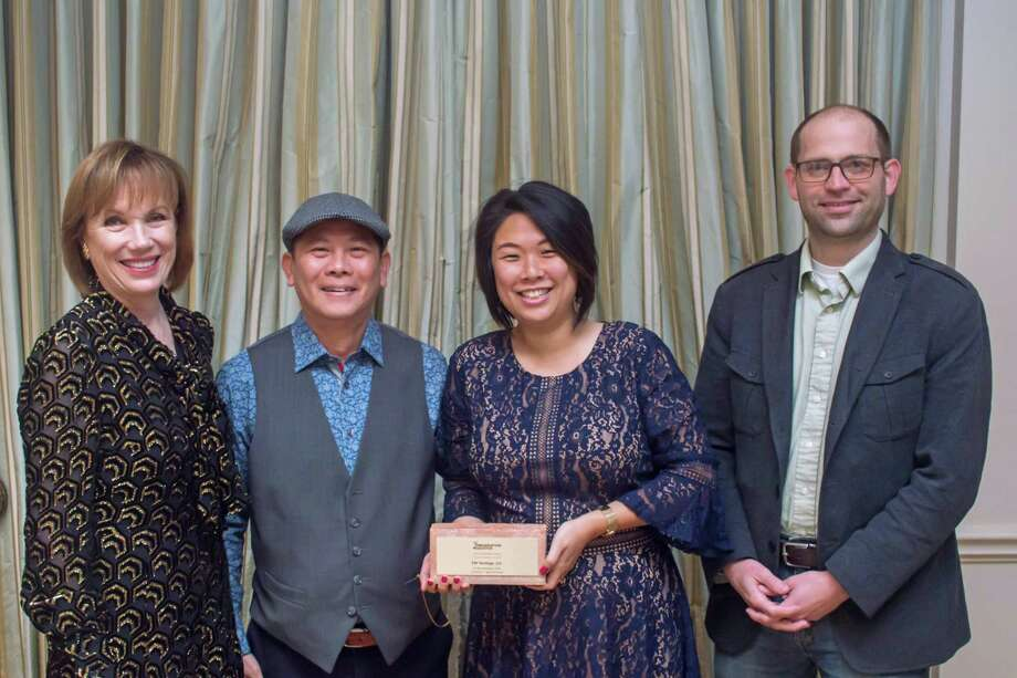 From left, Preservation Houston President Deborah Keyser, Dominic Yap and Lin Chong of FW Heritage, and David Jefferis of Grayform Architecture received a 2019 Good Brick Award for the restoration of the Frederick C. Bammel House (c. 1895) in the High First Ward Historic District. Photo: Isaac Arnold IV