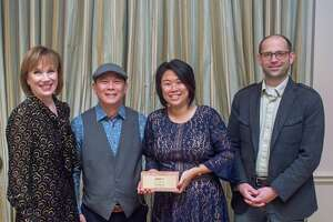 From left, Preservation Houston President Deborah Keyser, Dominic Yap and Lin Chong of FW Heritage, and David Jefferis of Grayform Architecture received a 2019 Good Brick Award for the restoration of the Frederick C. Bammel House (c. 1895) in the High First Ward Historic District.