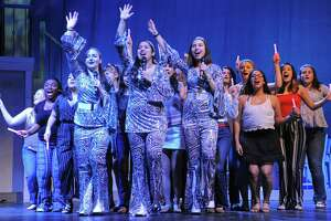 Emily Rooney portrays Donna Sheridan, center, Olivia Lapice portrays Rosie and Daniella Donzelli portrays Tanya, as The Brien McMahon High School Drama Club rehearses their 2019 production of Mama Mia Thursday, March 7, 2019, at the school in Norwalk, Conn.
