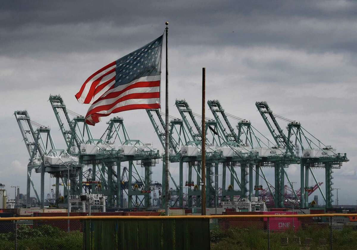 (FILES) In this file photo taken on March 4, 2019 the US flag flies over shipping cranes and containers in Long Beach, California. - The skyrocketing US trade deficit last year hit the highest level in a decade, a major setback for President Donald Trump's global trade offensive, government data showed on March 6, 2019. And the trade gaps with China, Mexico and the European Union all jumped to all-time highs even after Washington slapped tariffs on hundreds of billions in imports from its largest trading partners. (Photo by Mark RALSTON / AFP)MARK RALSTON/AFP/Getty Images